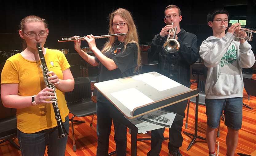 A group of students play their instruments